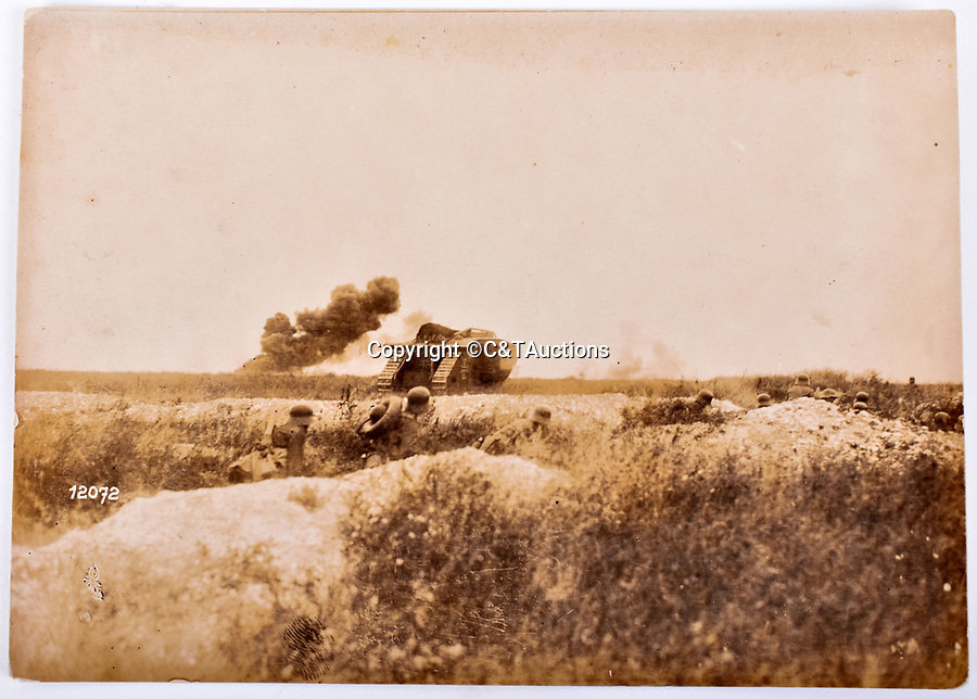 Bmth News (01202 558833)<br /> Pic: C&TAuctions/BNPS<br /> <br /> On manoeuveres - captured male Mark IV of either Abteilung 12 or 14, with German infantry in late 1918.<br /> <br /> Remarkable photographs revealing how the Germans used captured British tanks against us because theirs were no good have come to light over 100 years later.<br /> <br /> The British were the first to invent the tank in 1916 and a year later used them to overwhelm the enemy at the Battle of Cambrai in the First World War.<br /> <br /> Although the battle was a success for the British, the Germans captured several Mark IV tanks.<br /> <br /> Now black and white photos have emerged to show the German high command inspecting one the hulking machines in Berlin in 1918.<br /> <br /> Other pictures in the album depicts the early days of aerial warfare when hand grenades were dropped over the side of the cockpits by German pilots.