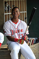 Designated hitter Rafael Devers (13) of the Greenville Drive waits in the dugout for a game against the Asheville Tourists on Thursday, August 13, 2015, at Fluor Field at the West End in Greenville, South Carolina. Asheville won, 8-1. (Tom Priddy/Four Seam Images)