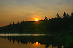 SUNRISE AT MCLEAN POND, NEAR BRAGG CREEK IN KANANASKIS COUNTRY, ALBERTA, CANADA