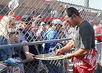March 23, 2013 Fontana, CA: Auto Club Speedway. Juan Pablo Montoya signs autographs before cup practice at the Auto Club Speedway