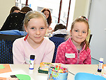 Cariosa Sweeney and Isabella Smith who took part in the St Patrick's art session in the Library. Photo:Colin Bell/pressphotos.ie