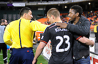 Washington, D.C.- March 29, 2014. D.C. United former player Clyde Simms greeting Perry Kitchen and  MLS referee Jorge Gonzalez and thanking them for their support during his kidney disease tribulations.  D.C. United defeated the New England Revolution 2-0 during a Major League Soccer Match for the 2014 season at RFK Stadium.