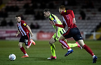 Bolton Wanderers' Daryl Murphy breaks under pressure from Lincoln City's Joe Morrell (left) and Cian Bolger (right) <br /> <br /> Photographer Andrew Kearns/CameraSport<br /> <br /> The EFL Sky Bet League One - Lincoln City v Bolton Wanderers - Tuesday 14th January 2020  - LNER Stadium - Lincoln<br /> <br /> World Copyright © 2020 CameraSport. All rights reserved. 43 Linden Ave. Countesthorpe. Leicester. England. LE8 5PG - Tel: +44 (0) 116 277 4147 - admin@camerasport.com - www.camerasport.com