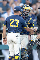 Michigan Wolverines catcher Joe Donovan (0) laughs with head coach Erik Bakich (23) against the Vanderbilt Commodores during Game 3 of the NCAA College World Series Finals on June 26, 2019 at TD Ameritrade Park in Omaha, Nebraska. Vanderbilt defeated Michigan 8-2 to win the National Championship. (Andrew Woolley/Four Seam Images)