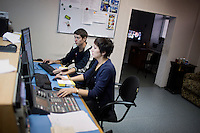 Television producers monitor broadcasts, including a live nightly news program, at the Telecenter (Teletsentr) studio of Bashkir state television and radio in Ufa, Bashkortostan, Russia.