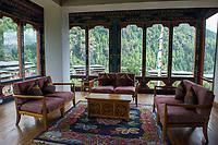 Bhutan, Paro, common sitting area of Zhiwa Ling Hotel.