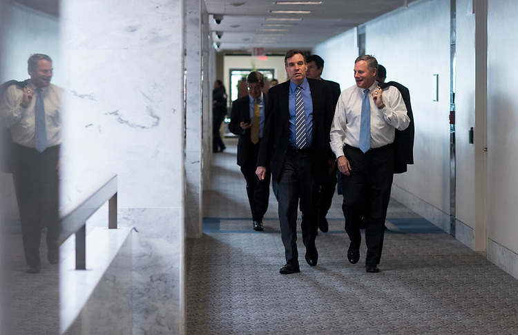 UNITED STATES - MARCH 15: Sen. Mark Warner, D-Va., left, and Sen. Richard Burr, R-N.C., arrive for a meeting with CIA Director Mike Pompeo in the Senate Intelligence Committee hearing room on Wednesday, March 15, 2017. (Photo By Bill Clark/CQ Roll Call)