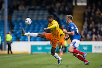 Rowan Liburd (Loanee from Reading) of Wycombe Wanderers controls under pressure from Matthew Clarke of Portsmouth during the Sky Bet League 2 match between Portsmouth and Wycombe Wanderers at Fratton Park, Portsmouth, England on 23 April 2016. Photo by Andy Rowland.