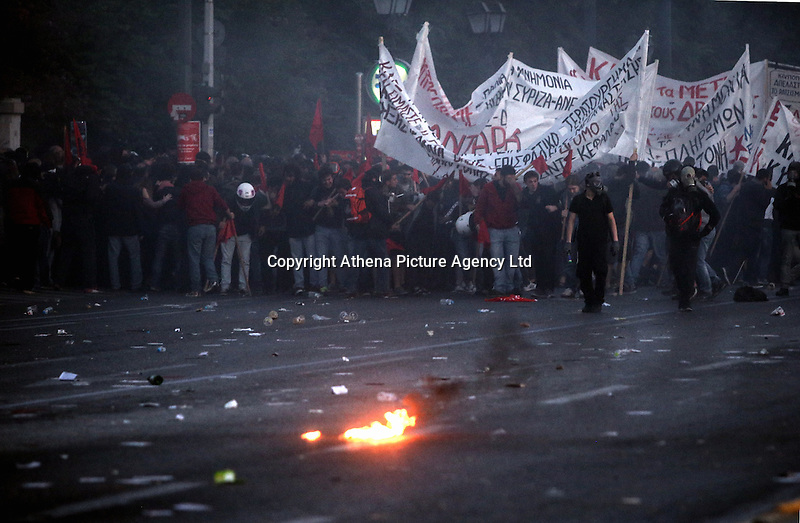 Pictured: Rioters with flags and banners Sunday 09 May 2016<br /> Re: Riots break out between protesters and police in Syntagma Square, while MPs in the Greek Parliament vote for new tax, pension and welfare reforms in Athens, Greece