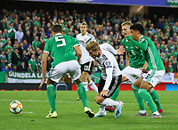 Timo Werner (Deutschland Germany) hat sich wieder festgelaufen an Ciaron Brown (Nordirland, Northern Ireland) - 09.09.2019: Nordirland vs. Deutschland, Windsor Park Belfast, EM-Qualifikation DISCLAIMER: DFB regulations prohibit any use of photographs as image sequences and/or quasi-video.