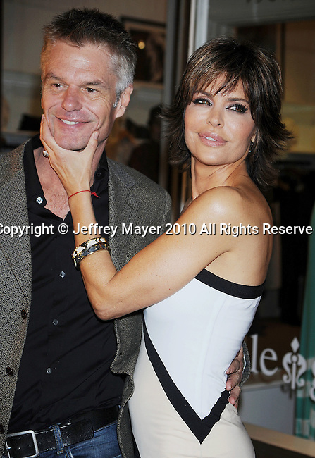 """SHERMAN OAKS, CA. - February 12: Harry Hamlin and Lisa Rinna attend the taping of TV Land docu-soap """"Harry Loves Lisa"""" at Belle Gray Boutique's 7th Anniversary at Belle Gray Boutique on February 12, 2010 in Sherman Oaks, California."""