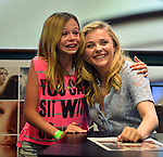 MIAMI, FL - AUGUST 01: Chloe Grace Moretz poses for picture and selfie with crying fans while signing copies of the book 'If I Stay' at Barnes & Noble Booksellers on Friday August 1, 2014 in Miami, Florida. (Photo by Johnny Louis/jlnphotography.com)