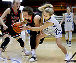 February 28, 2020; Yankton at St. Thomas More High School Basketball -- Ellie Karolevitz #5 of Yankton tries to keep the ball from Jenna Jacobson #1 of St. Thomas More during their game Friday evening at Barnett Arena in Rapid City, S.D.(Photo by Richard Carlson/Inertia)