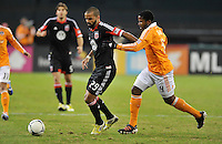D.C. United forward Santos Maicon (29) goes against Houston Dynamo Defender Jarmaine Taylor (4) D.C. United tied The Houston Dynamo 1-1 but lost in the overall score 4-2 in the second leg of the Eastern Conference Championship at RFK Stadium, Sunday November 18, 2012.