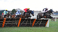 The Tin Miner (r) ridden by Tom Cannon jump the last in  The Strong Flavours Catering Handicap Hurdle    during Horse Racing at Plumpton Racecourse on 10th February 2020