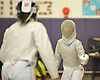Elin Hu of Manhasset, right, battles Shannon Sarker of Great Neck North during the Nassau County girls' fencing saber final at Oyster Bay High School on Saturday, Jan. 30, 2016. Hu won 15-12 to claim the county title.
