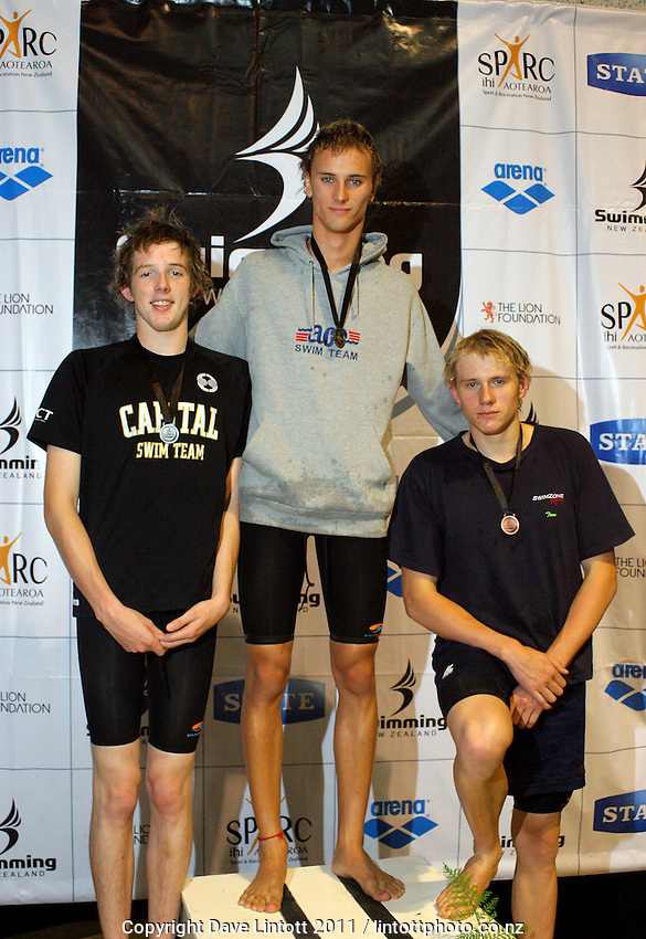 17-18yo Boys 100m breaststroke podium, from left, Benjamin McFetridge (2), Shayne Kiekebosch (1) and Tom Ward (3). New Zealand Age Group Swimming Championships day five at Welllington Aquatics Centre, Kilbirnie, Wellington, New Zealand on Saturday, 5 March 2011. Photo: Dave Lintott / lintottphoto.co.nz