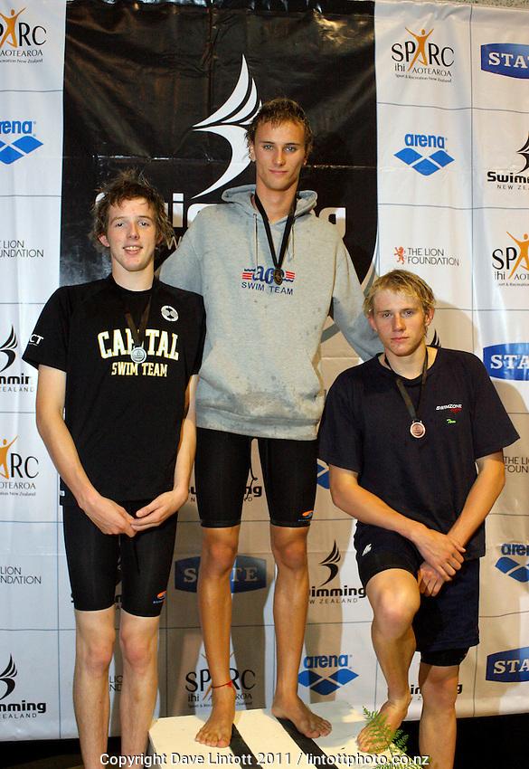 17-18yo Boys 100m breaststroke podium, from left, Benjamin McFetridge (2), Shayne Kiekebosch (1) and Tom Ward (3). New Zealand Age Group Swimming Championships day five at Welllington Aquatics Centre, Kilbirnie, Wellington, New Zealand on Saturday, 5 March 2011. Photo: Dave Lintott / lintottphoto.co.nz