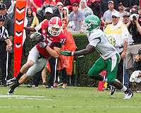 The Georgia Bulldogs played North Texas Mean Green at Sanford Stadium.  After North Texas tied the game at 21 early in the second half, the Georgia Bulldogs went on to score 24 unanswered points to win 45-21.  Georgia Bulldogs wide receiver Rhett McGowan (27), North Texas Mean Green defensive back James Jones (13)