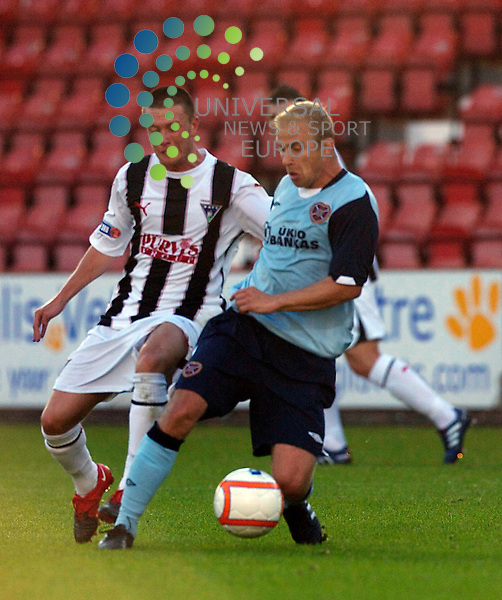 Pre  Season 2010/11.Dunfrmline Ath Football Club  V Hearts Football Club...   Dunfermlines Callum Woods with Hearts Finnish Trialist Kari Arkivuo, in  this evening's pre seaon friendly...At East End  Park,Dunfermline...Picture, Mark Davison/Universal News and Sport.