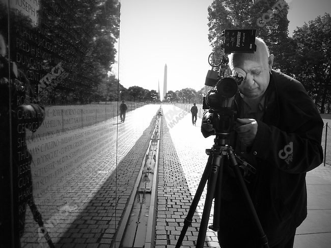 Film-maker/photographer Raymond Depardon shooting footage at the Vietnam Memorial. Washington, D.C., June 2, 2008.