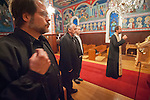Dan Stojanovich crosses as Father Budimir Andjelic and Miloje Milinkovic repectfully listen to  Father Blasko Paraklis as he chants prayers to the memory of the departed at St. Sava Church, Jackson.