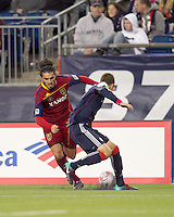 Real Salt Lake forward Fabian Espindola (7) dribbles and New England Revolution midfielder Chris Tierney (8) defends. Real Salt Lake defeated the New England Revolution, 2-1, at Gillette Stadium on October 2, 2010.