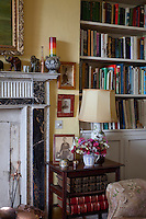 The family sitting room is furnished with well-worn chintz armchairs and memorabilia