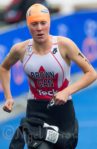26 AUG 2012 - STOCKHOLM, SWE - Joanna  Brown (CAN) of Canada  heads for transition at the end of her swim during the 2012 ITU Mixed Relay Triathlon World Championships in Gamla Stan, Stockholm, Sweden (PHOTO (C) 2012 NIGEL FARROW)