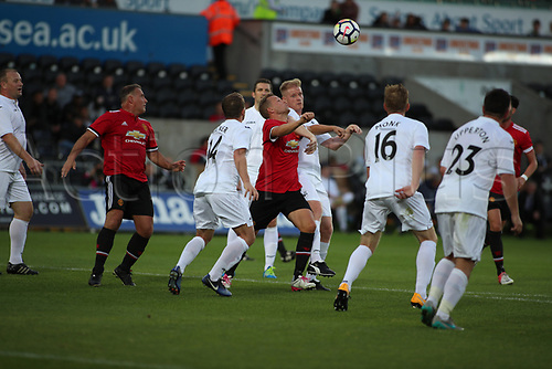 August 9th 2017, Liberty Stadium, Swansea, Wales; Alan Tate Testimonial Match; Swansea City Legends XI versus Manchester United Legends XI; Erik Nevland of Manchester United Legends and Alan Tate of Swansea City Legends battle for ball as it is crossed into the box