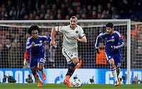 Zlatan Ibrahimovic of Paris Saint-Germain moves away from Willian of Chelsea & Diego Costa (right) of Chelsea during the UEFA Champions League Round of 16 2nd leg match between Chelsea and PSG at Stamford Bridge, London, England on 9 March 2016. Photo by Andy Rowland.