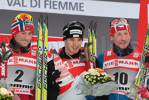 09.01.2011.  TOUR DE SKI - STAGE 8 - FINAL CLIMB. Overall podium with from left to right Petter NORTHUG, Cologna DARIO, Lukas BAUER after the final climb of Cermis in Val Di Fiemme, Italy.