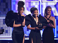 Halle Bailey, left, and Chloe Bailey, of Chloe X Halle, present the award for best rap album at the 61st annual Grammy Awards on Sunday, Feb. 10, 2019, in Los Angeles. (Photo by Matt Sayles/Invision/AP)