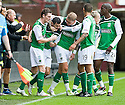 HIBERNIAN'S IVAN SPROULE IS CONGRATULATED  AFTER HE SCORES HIBS FIRST
