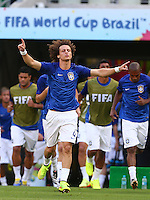 David Luiz of Brazil prays as he comes out to warm up before kick off
