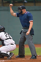 Home plate umpire Brandon Henson calls a strike during the Appalachian League contest between the Eliabethton Twins and the Bristol Sox at Boyce Cox Field in Bristol, TN, Thursday July 4, 2008.