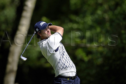 25 May 2006: Australian golfer Adam Scott (AUS) watches his shot from the 5th Tee during the first round of the BMW Championship, played on the West Course at Wentworth. Photo: Glyn Kirk/Actionplus...060525 golf man male