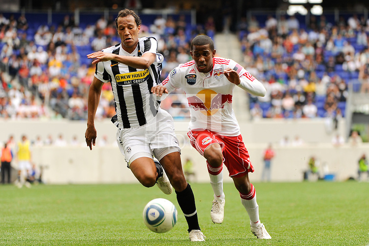 Jonathan Zebina (15) of Juventus F. C. and Jeremy Hall (17) of the New York Red Bulls race for the ball. The New York Red Bulls defeated Juventus F. C. 3-1 during a friendly at Red Bull Arena in Harrison, NJ, on May 23, 2010.