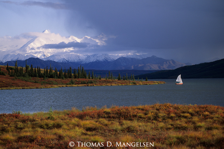Sailing on Wonder Lake below the massive Alaska Range in Denali National Park, Alaska.
