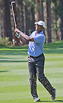 Fred McGriff, former MLB All Star, hits an approach shot at the Edgewood Tahoe Golf Course during the American Century Championship on Wednesday, July 16, 2014.