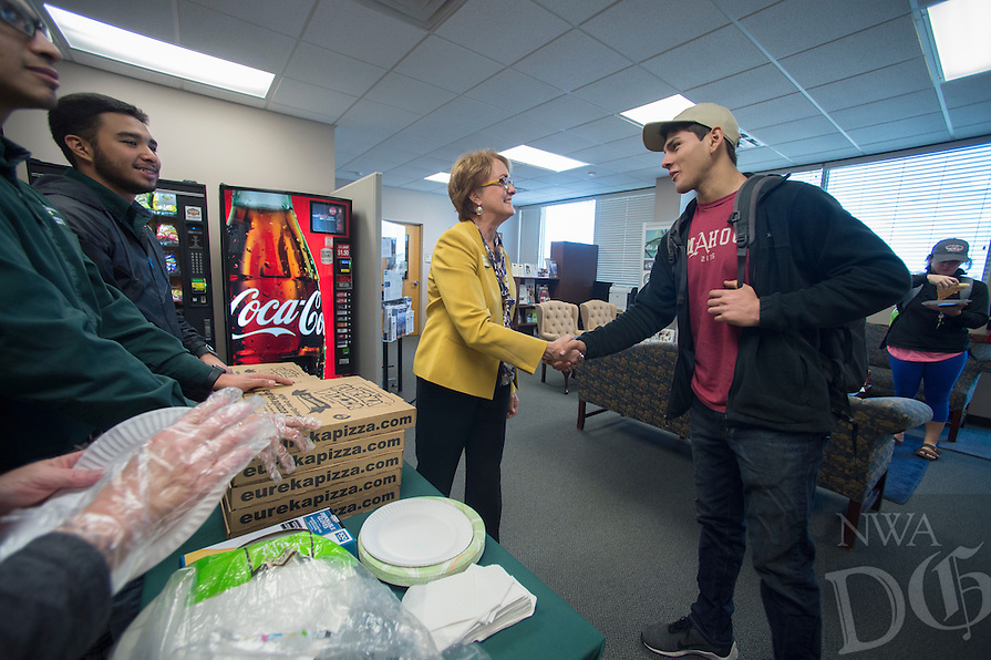 NWA Democrat-Gazette/J.T. WAMPLER Northwest Arkansas Community College president Dr. Evelyn Jorgenson shakes hands with student Jaime Gonzalez of Fayetteville Wednesday Feb. 8, 2017 at the school's Springdale campus. Jorgenson has been visiting the school's campuses and giving students free pizza to students and staff for a mid-semester boost.