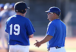 Wildcats Coach Ryan Gonzalez talks with Bradley Lewis during a college baseball game at Western Nevada College in Carson City, Nev., on Thursday, March 5, 2015. <br /> Photo by Cathleen Allison/Nevada Photo Source