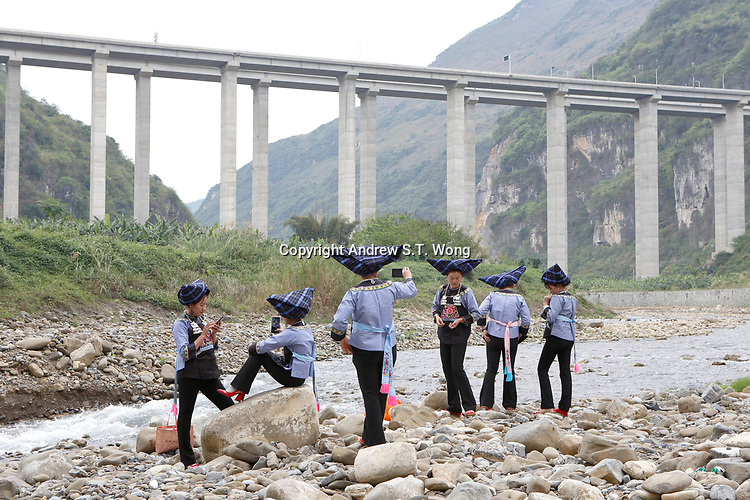 Women of the ethnic Bouyei Tribe chat underneath a highway bridge at Wangmo County in China's southwestern Guizhou Province, April 2019.