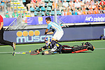 The Hague, Netherlands, June 13: Joaquin Menini #11 of Argentina tries to score during the field hockey semi-final match (Men) between Australia and Argentina on June 13, 2014 during the World Cup 2014 at Kyocera Stadium in The Hague, Netherlands. Final score 5-1 (3-0)  (Photo by Dirk Markgraf / www.265-images.com) *** Local caption *** Joaquin Menini #11 of Argentina, Andrew Charter #30 of Australia