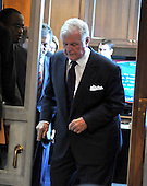 """Washington, D.C. - January 8, 2009 -- United States Senator Edward M. """"Ted"""" Kennedy uses a cane as he walks to his chair prior to hearing former United States Senator Tom Daschle (Democrat of South Dakota) testify before the United States Senate Committee on Health, Labor, Education, and Pensions on his nomination to be Secretary of Health and Human Services in Washington, D.C. on Thursday, January 8, 2009..Credit: Ron Sachs / CNP"""