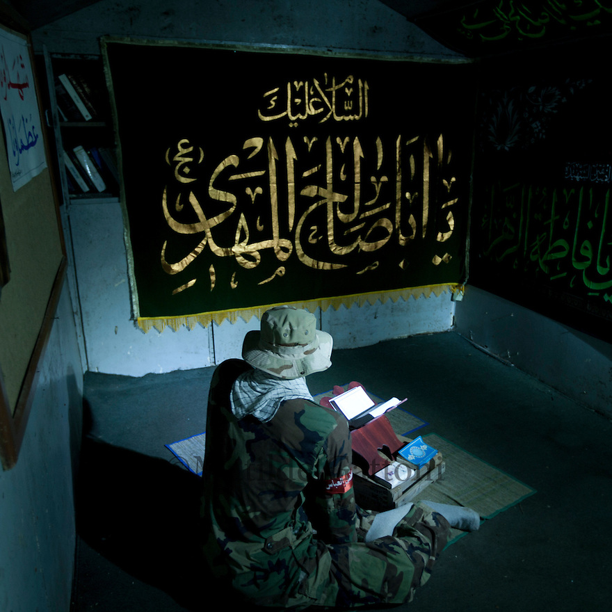 Fake Hezbollah fighter praying inside the bunker in Mleeta Museum. Mleeta tourist landmark of the resistance in Lebanon is a natural museum, which inventively displays the Israeli spoils of war and the resistance weapons in open air on a land of 60,000 m2 of gardens and woods with 5,000 m2 of buildings.It is formed of several sections with outstanding architecture that combines the landmark with natural woods and a large cave. These sections vary from each other in order to portray the story of the resistance against the Israeli enemy in different shapes. The visitor will be aquatinted closely with the methods that the resistance employed to produce liberation in 2000 and victory in 2006.