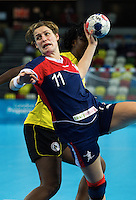 23 NOV 2011 - LONDON, GBR - Britain's Lyn Byl (#11, in blue) shoots during the 2011 London Handball Cup match against Angola at The Handball Arena in the Olympic Park in Stratford, London .(PHOTO (C) NIGEL FARROW)