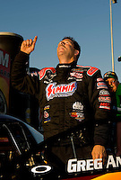 Sept. 19, 2010; Concord, NC, USA; NHRA pro stock driver Greg Anderson celebrates after winning the O'Reilly Auto Parts NHRA Nationals at zMax Dragway. Mandatory Credit: Mark J. Rebilas-