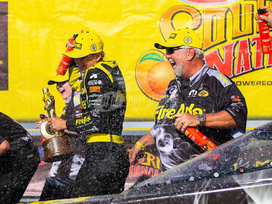 May 6, 2018; Commerce, GA, USA; NHRA top fuel driver Leah Pritchett (left) celebrates with sponsor Ron Thames after winning the Southern Nationals at Atlanta Dragway. Mandatory Credit: Mark J. Rebilas-USA TODAY Sports