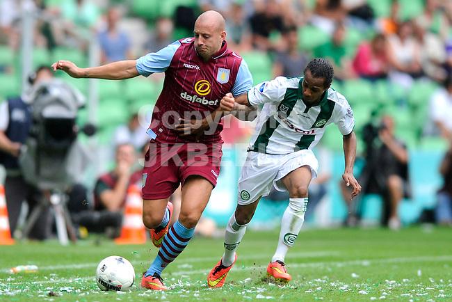 GRONINGEN - Voetbal, FC Groningen - Aston Villa, voorbereiding seizoen 2014-2015, 02-08-2014,  FC Groningen speler Jarchinio Antonia  met Alan Hutton